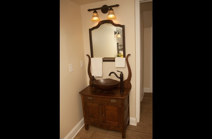 Antique washstand vanity and copper vessel sink