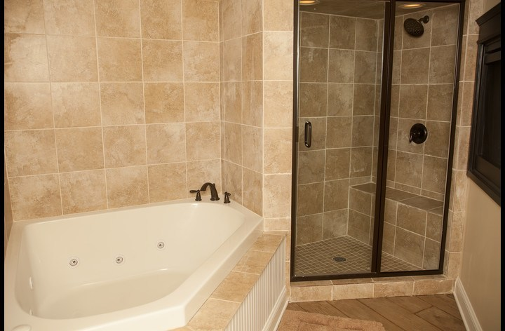 Master bath with oversized tub and dual shower heads