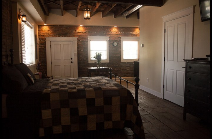 Exposed brick walls and original beamed ceiling