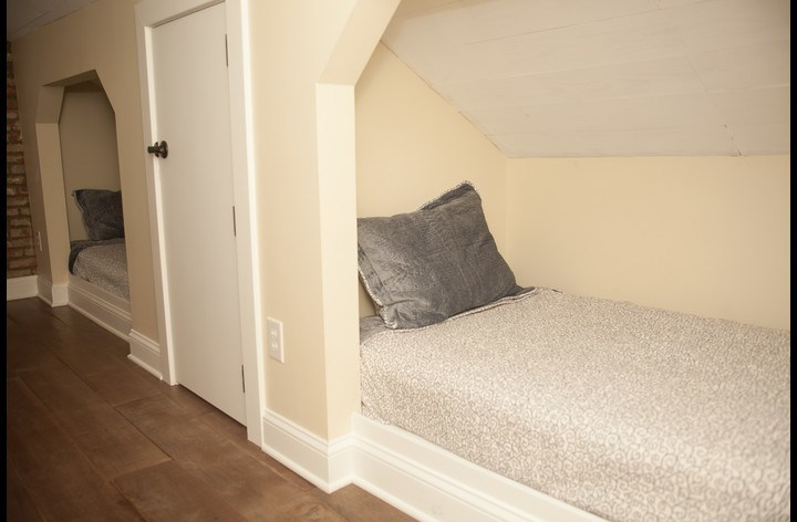 Cozy built in twin beds in upstairs bedroom